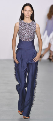 ANTONIO BERARDI The conservative design captures the eyes of glamour lovers with the sparkly halter top and fringe lined pants.