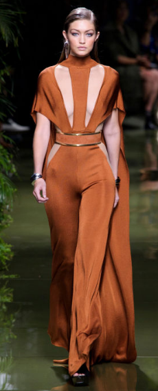 BALMAIN Everything about Olivier Rousteing's show defined how to live the lush life featuring verdant greenery of the hanging plants and the runway models' curves.