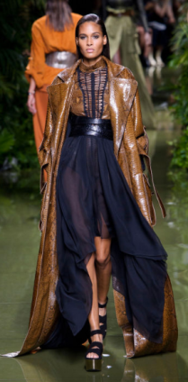 BALMAIN Olivier Rousteing focused on exotics and knits, managing both concepts of conservative and sexy - this look seems to both cover up the model while portraying her as edgy and promiscuous by throwing on layers but offering teases of leg and chest.