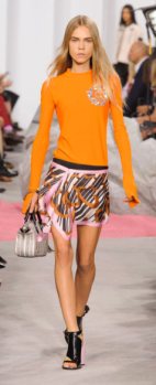 CARVEN The runway looks is easily worn off the runway as it's a simple sweater paired with a patterned skirt to excite the subtle design.