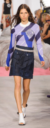 CARVEN The colorblock sweater paired with a simple texturized skirt and chunky belt is easily worn off the runway.