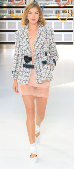 "CHANEL ""The bouclé-suited bots were a hint at what was to come"" as Karl Lagerfeld aimed to transcend the traditional lady's look with age putting an 80s twist on Chanel's signature tweed suit."