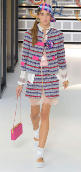 "CHANEL Tweed suits are everywhere in just about every color combination - subtle traditional blends to brighter hues featuring hot pink velvet straps - layering lacy underskirts and slip dresses. The runway designs ""all referred back to their original influence - the Chanel Suit 1.0"""