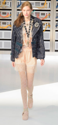 CHANEL A charming and humorous take on old-meets-new, the classic tweed jacket keeps the traditional style in style.