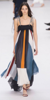 CHLOE The vibrant colors contrast the all black top. The flow of the skirt lightens up a heavy color combination.
