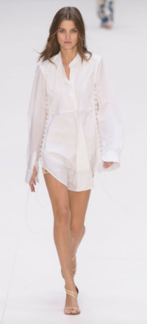 CHLOE The always innocent designs featured some sexy lingerie details but remained subtle with white tuxedo shirts and camisoles with tiny buttons and built in bras - some with a filmy sheer quality.