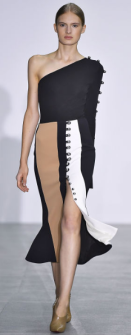 DAVID KOMA The single off the shoulder and the mid-skirt slit create a sexy vibe to an otherwise subtle dress. The use of neutral on the skirt gives the illusion of a longer slit. The shoulder embellishments allow for an edgier vibe to a conservative long peplum dress.