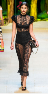 DOLCE & GABBANA The black lace creates an edgy dark vibe that is lightened by the see-through element encompassing most of the design.