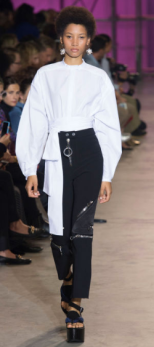 ELLERY The puffy white blouse compliments the dark lengthy pants with its metal details.