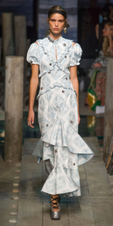 "ERDEM Inspired by a historical romance, Moralioglu added slits to the shoulders and waists of his fit-and-flare day dresses for subtle ""peekaboo"" elements, in addition to the pretty prints."