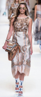 FENDI The chunky sunglasses add to the already high-fashion chicness of the design. The tucked in halter top and long flowing skirt create a casual sense to an extravagant style.
