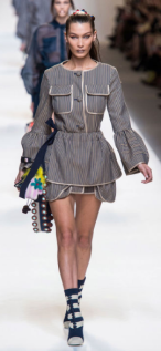 "FENDI The ultra chic bell-sleeved mini skirt dress screams ""mistress"" as the sexy revealing length is encouraged by the high heels."
