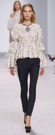 GIAMBATTISTA VALLI The casual ruffled romantic blouse paired with tailored evening pants is ready-to-wear for a Saturday afternoon shopping or a Sunday morning brunch with the girls.