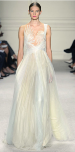 MARCHESA Beautiful goddess design as such with a criss-cross white, cream and pastel chiffon pleated detail and ballet feathers at the bodice.