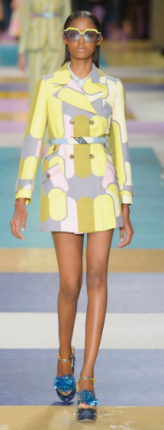 MIU MIU A collection of coats featuring tailored, cleaned-up silhouettes in pastel abstracts or bright monotones, as well as, trenches with girlish white-piping and printed furs worn like house robes.