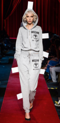 """MOSHINO The street style sweatpants design promotes the brand """"Moschino"""" on both the sweatshirt and pants. The high heels are not """"too much"""" as the clothing itself is only a subtle gray."""