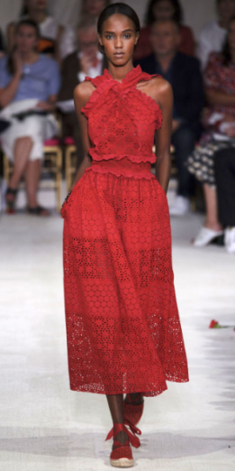 OSCAR DE LA RENTA Peter Copping subtly combined the ideas of daytime casual with evening cocktail to create eyelet dresses with criss-cross halters - often paired with espadrilles - and a dressier notion of a race car shade of red.