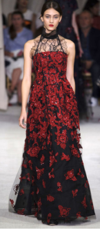 OSCAR DE LA RENTA Each evening dress caught every dramatic eye as black lace seemed to be the common thread in either the asymmetric tiers of a halter dress or layered under strapless gowns.