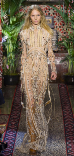 ROBERTO CAVALLI The sequined goddess-like dress glows as the sections barred from sequins leave nothing to hide behind the mesh-like fabric exhibiting the see-through effect.