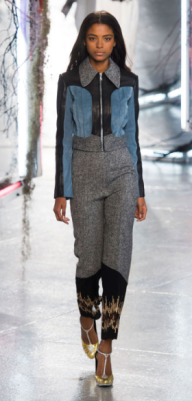 RODARTE The metallic aspect of the show was minorly interrupted by some more subtle looks featuring this tweed-and-suede trim little suit, which still contributed to the rocker-glam vibe with its sequined hems and glittering shoes.
