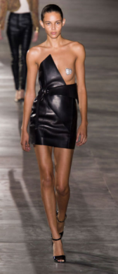 SAINT LAURENT The short and tight black leather dress brings back the edgy 80s style we all love and no longer have to miss.