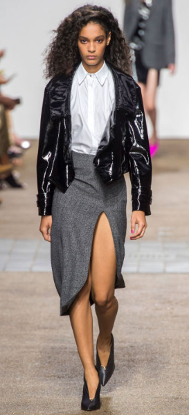 TOPSHOP UNIQUE The punk inspired design includes a collared menswear white blouse, a black patent leather jacket, a gray slit skirt and black heels creating a sexy edgy vibe to modern workwear.