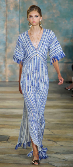 TORY BURCH Uptown in Lincoln Center, the designer featured embroidered and natural fabrics in her Spring collection against some glitter on shorts, tunics and gowns.