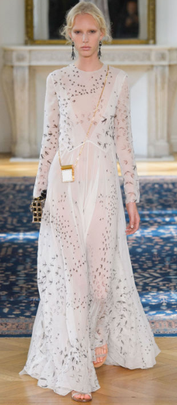 VALENTINO The innocence of the color palette represented graciousness - seen by the white, muted yellows and vibrant pinks. A range of silhouettes was displayed recalling the conservative styles of the 1920s.