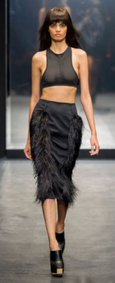VERA WANG The evening show featured feathers, fringe, and sequins as the detail to bared midriffs, negligees, slips and halter dresses.
