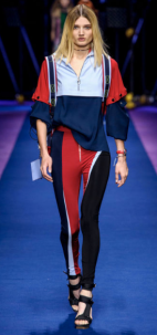 VERSACE The colorblock three-quarter zip and sleeve top and tight leggings become professional when paired with a pair of strappy open-toed black heels.
