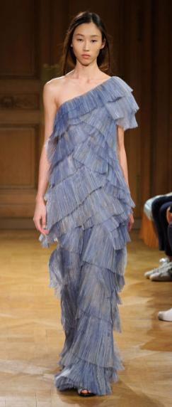 VIONNET Focusing on casual looks and day wear, the dramatically tiered one-shoulder gown was constructed of layers upon layers of pleated denim-colored panels.